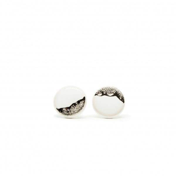 white earrings with platinum coast platinum clayometry